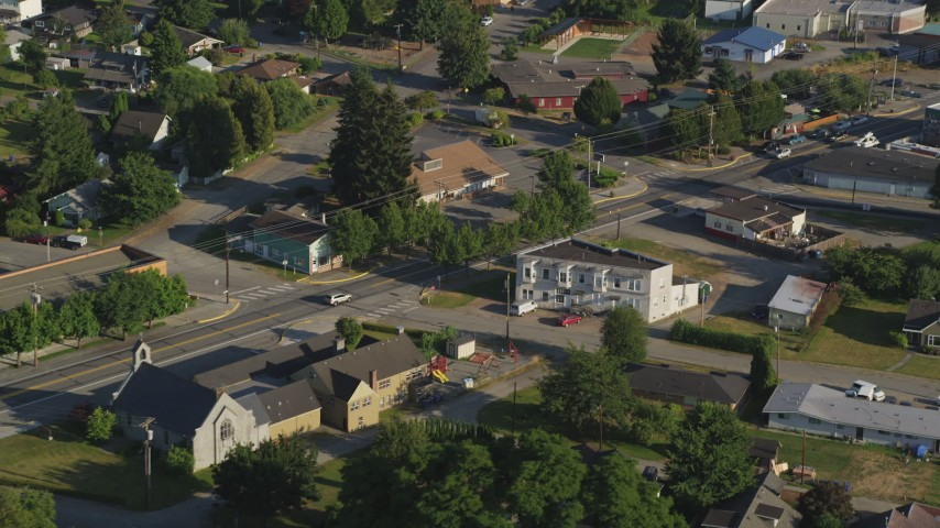 5K stock footage aerial video of tracking a silver SUV on a road through a rural neighborhood, Carnation, Washington Aerial Stock Footage | AX49_019