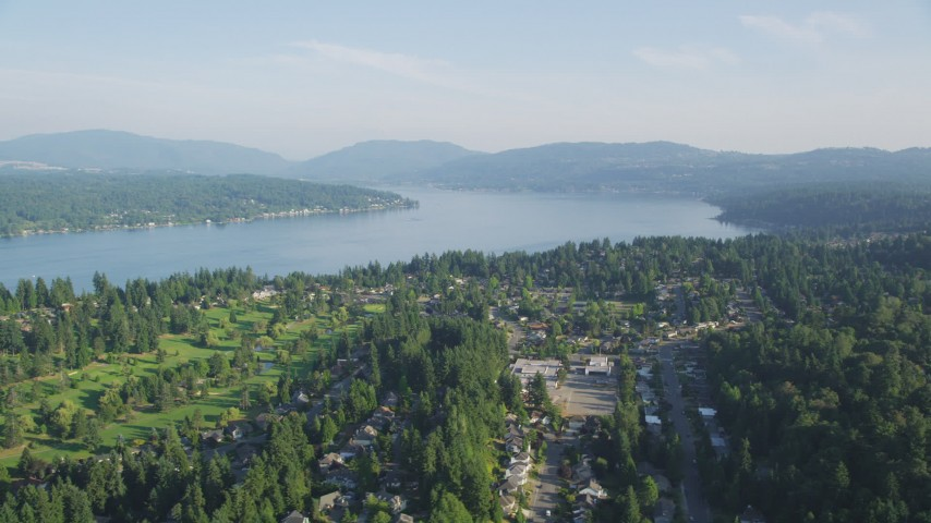 5K stock footage aerial video of Lake Sammamish seen from suburban neighborhoods in Bellevue, Washington Aerial Stock Footage | AX49_034
