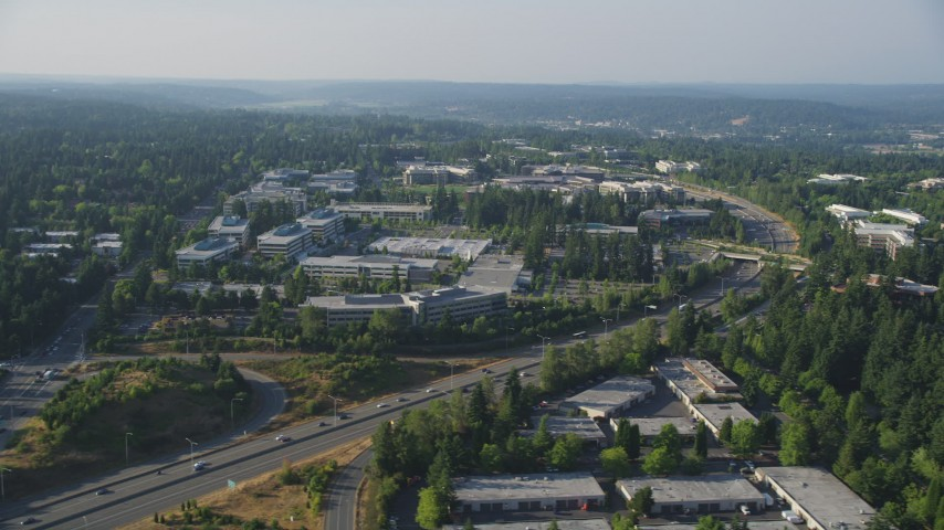 5K stock footage aerial video of Microsoft Headquarters office buildings and light traffic on State Route 520 in Redmond, Washington Aerial Stock Footage | AX49_037