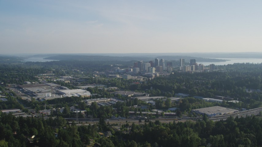 5K stock footage aerial video approach Downtown Bellevue, Washington, from warehouse building northeast of the city Aerial Stock Footage | AX49_047