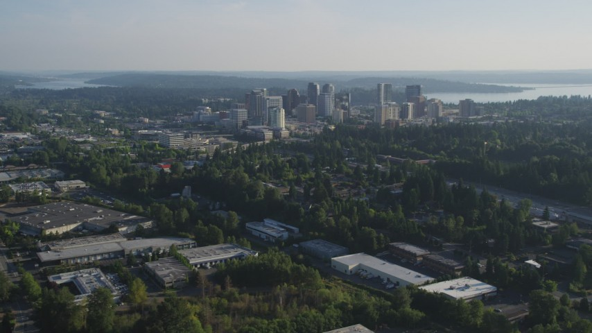 5K stock footage aerial video of a view of Downtown Bellevue, Washington, from warehouse buildings Aerial Stock Footage | AX49_048