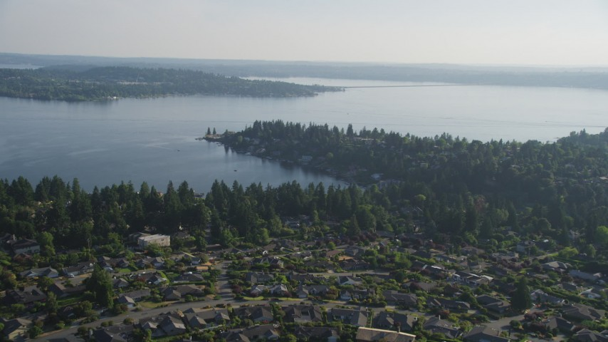 5K stock footage aerial video fly over suburban neighborhoods toward waterfront homes on Lake Washington, Bellevue, Washington Aerial Stock Footage | AX49_051