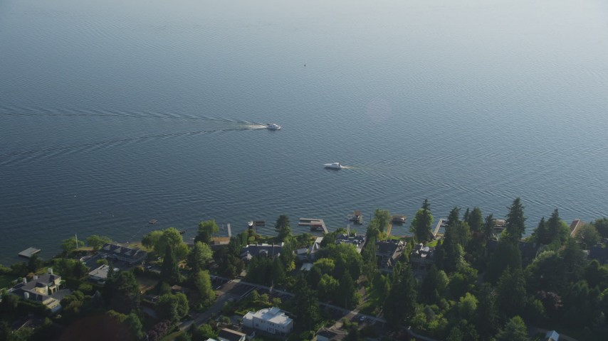 5K stock footage aerial video fly over lakeside houses to approach fishing boats on Lake Washington, Bellevue, Washington Aerial Stock Footage | AX49_053