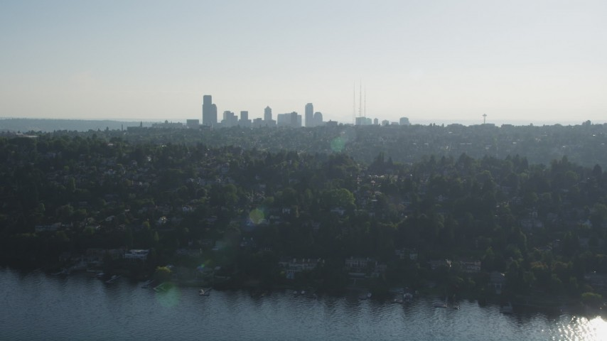 5K stock footage aerial video of a view of the Downtown Seattle skyline from lakeside homes in Madrona, Washington Aerial Stock Footage | AX49_054