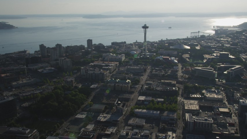 5K stock footage aerial video approach the world famous Space Needle in Downtown Seattle, Washington, with Elliott Bay in the background Aerial Stock Footage | AX49_060