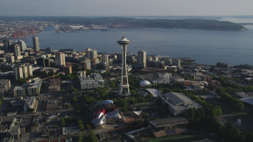 5K stock footage aerial video of orbiting the Space Needle to reveal Downtown Seattle skyscrapers and high-rises, Washington Aerial Stock Footage AX49_062 | Axiom Images