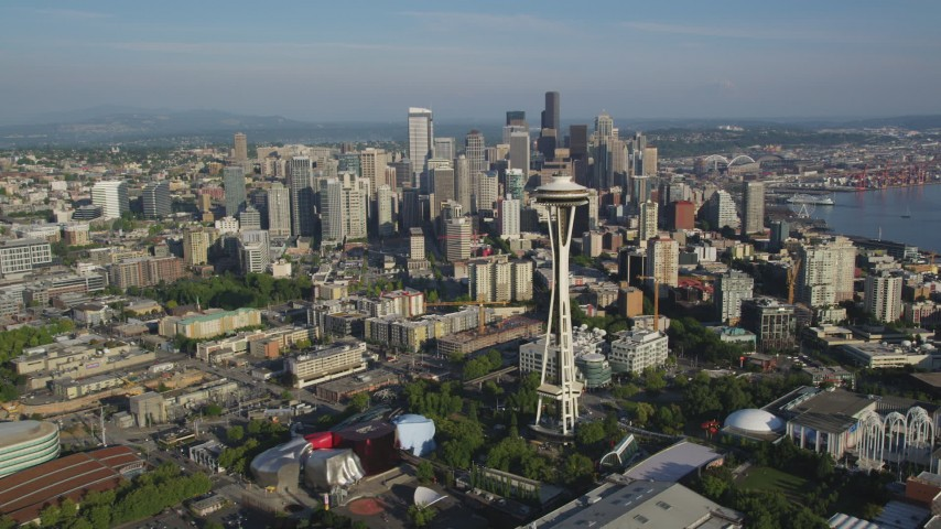 5K stock footage aerial video fly by the Space Needle to approach high-rises and skyscrapers, Downtown Seattle, Washington Aerial Stock Footage | AX49_063