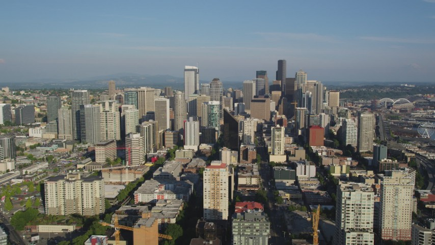 5K stock footage aerial video flyby skyscrapers to reveal the Viaduct, and the Seattle Great Wheel at the Central Waterfront, Downtown Seattle, Washington Aerial Stock Footage | AX49_064