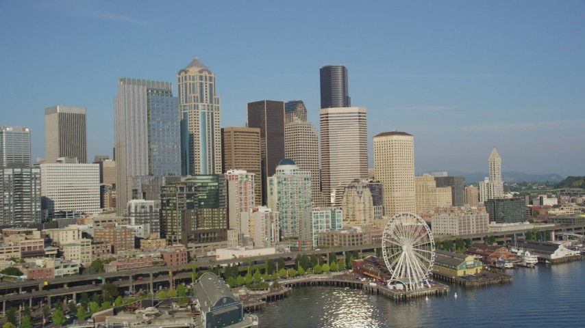 5K stock footage aerial video of Seattle Great Wheel, Waterfront piers and the Downtown Seattle skyline in Washington Aerial Stock Footage | AX49_065