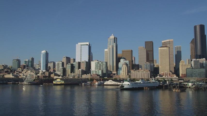 5K stock footage aerial video of the Downtown Seattle skyline and the Central Waterfront seen from Elliott Bay, Washington Aerial Stock Footage AX49_066 | Axiom Images