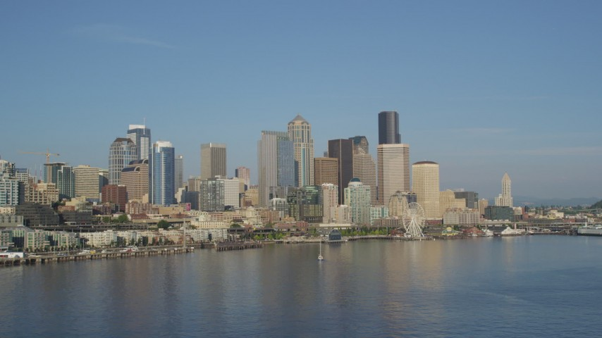 5K stock footage aerial video of the Central Waterfront and downtown skyline seen from Elliott Bay, Downtown Seattle, Washington Aerial Stock Footage | AX49_069
