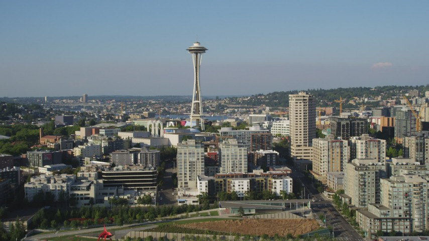 5K stock footage aerial video approach the Space Needle and Seattle Center from Elliott Bay, Downtown Seattle, Washington Aerial Stock Footage | AX49_070