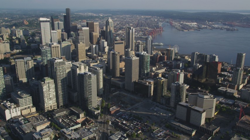 5K stock footage aerial video of passing by Downtown Seattle's high-rises and skyscrapers in Washington Aerial Stock Footage | AX49_073
