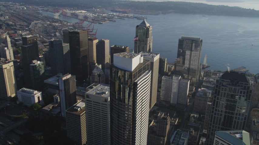 5K stock footage aerial video flyby tall Downtown Seattle skyscrapers and track Two Union Square with an American flag in Washington Aerial Stock Footage | AX49_074