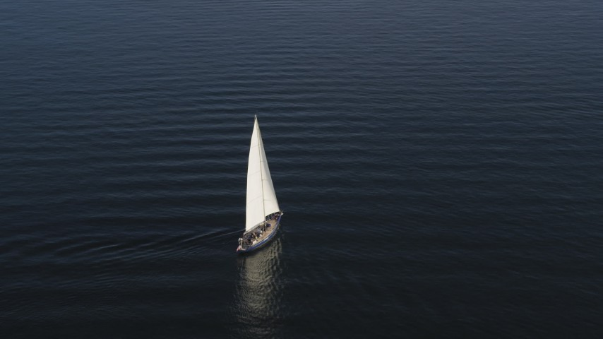 5K stock footage aerial video of tracking a sailboat on the bay on Elliott Bay, Seattle, Washington Aerial Stock Footage | AX49_077