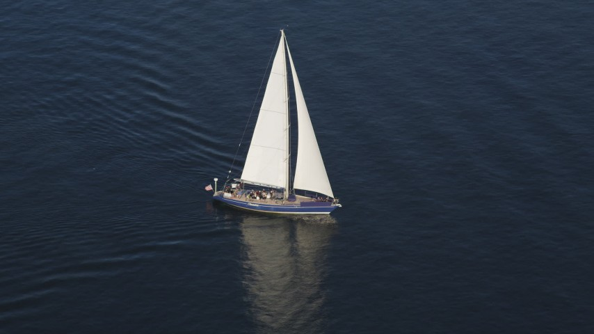 5K stock footage aerial video track a sailboat sailing on Elliott Bay, Seattle, Washington Aerial Stock Footage | AX49_078