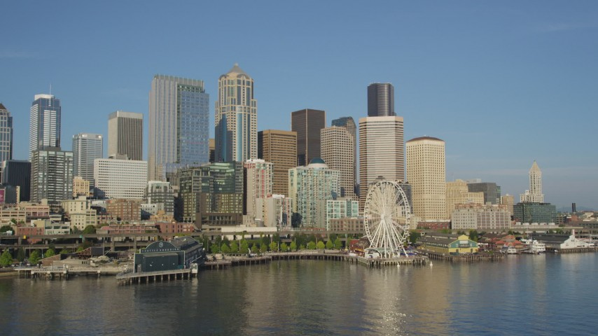 5K stock footage aerial video of Seattle Aquarium and Great Wheel on the Central Waterfront, and skyline of Downtown Seattle, Washington Aerial Stock Footage | AX49_081