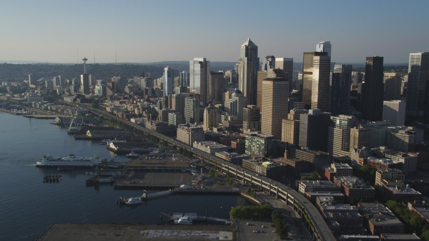 5K stock footage aerial video approach Ferry Terminal, and the Central Waterfront, Downtown Seattle, Washington Aerial Stock Footage | AX49_084