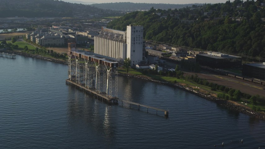 5K stock footage aerial video flyby grain elevator on the shore of Elliott Bay in Seattle, Washington Aerial Stock Footage | AX49_088