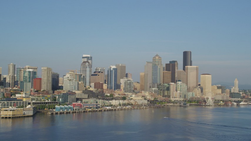 5K stock footage aerial video of Downtown Seattle skyline and Waterfront seen from Elliott Bay, Washington Aerial Stock Footage | AX49_091