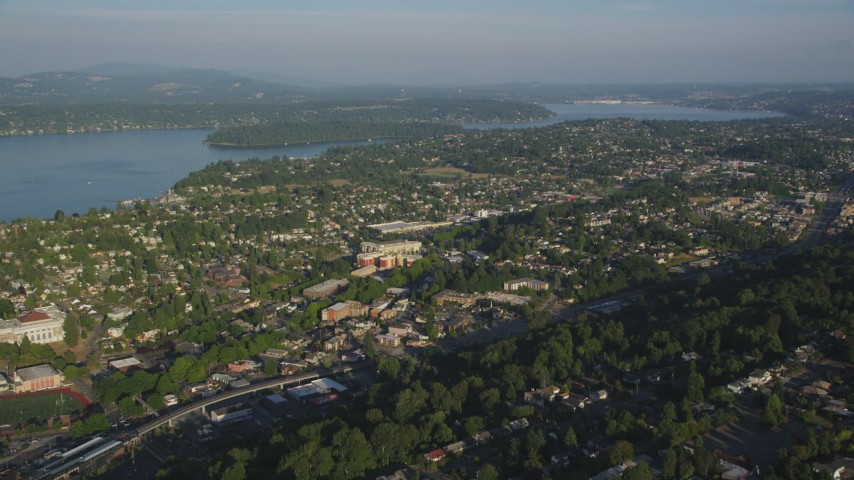 5K stock footage aerial video of suburbs in Rainier Valley, Seattle, Washington, and approach Lake Washington Aerial Stock Footage | AX49_095