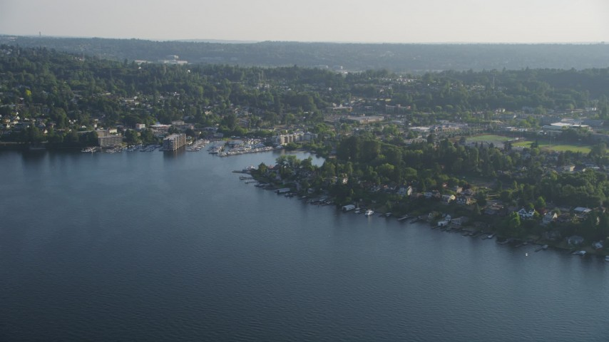 5K stock footage aerial video of lakefront homes on the shore of Lake Washington by marina, Rainier Beach, Seattle, Washington Aerial Stock Footage | AX49_099