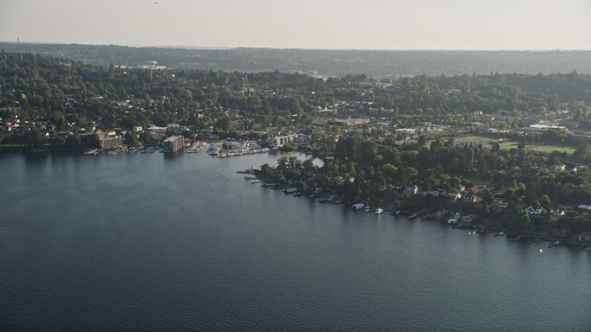 5K aerial video of lakefront homes on the shore of Lake Washington by marina, Rainier Beach, Seattle, Washington Aerial Stock Footage | AX49_099