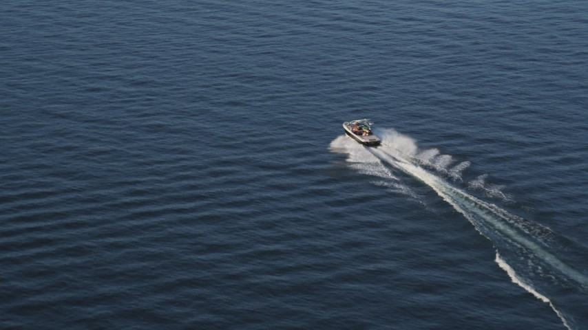 5K aerial video of tracking a speedboat on the Lake Washington Aerial Stock Footage | AX49_100