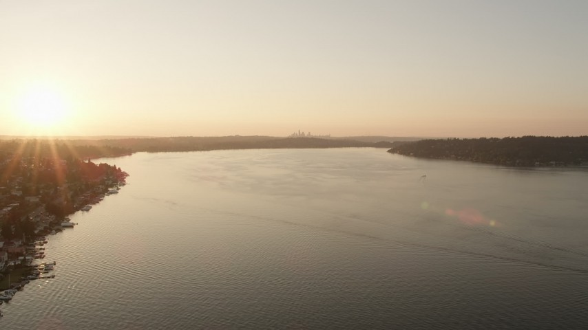 5K stock footage aerial video of flying over Lake Washington toward the setting sun Aerial Stock Footage | AX50_001