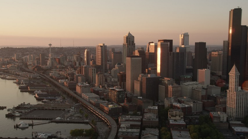 5K stock footage aerial video of Downtown Seattle skyscrapers and Central Waterfront piers in Washington, sunset Aerial Stock Footage | AX50_009