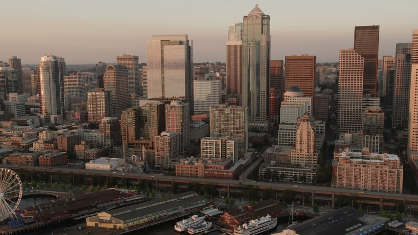 5K stock footage aerial video flyby Downtown Seattle's tall skyscrapers and the Central Waterfront in Washington, sunset Aerial Stock Footage | AX50_010