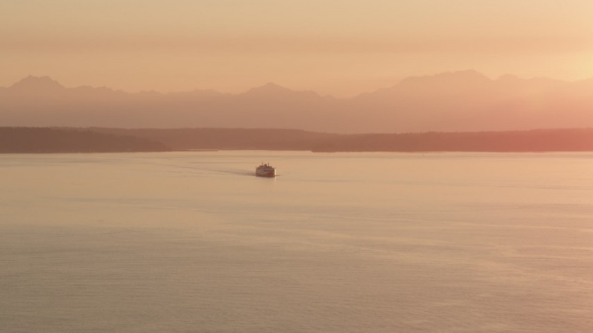 5K stock footage aerial video of ferry crossing Elliott Bay at sunset, Washington Aerial Stock Footage | AX50_012