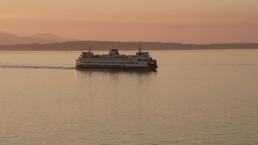5K stock footage aerial video of tracking a ferry crossing Elliott Bay, Washington, sunset Aerial Stock Footage   AX50_014