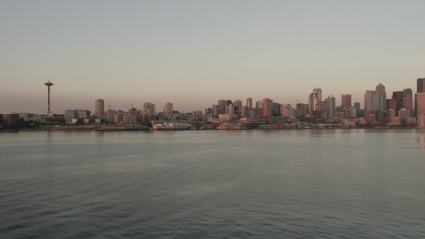 5K stock footage aerial video of approach to the Space Needle and the Downtown Seattle skyline at sunset from Elliott Bay, Washington Aerial Stock Footage | AX50_019