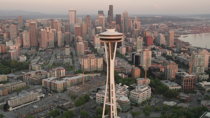 5K stock footage aerial video orbit the Space Needle and Seattle Center to reveal Downtown Seattle skyscrapers, Washington, sunset Aerial Stock Footage | AX50_021