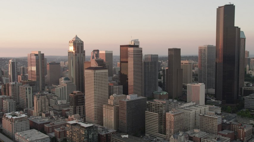 5K stock footage aerial video orbit skyscrapers on the south side of Downtown Seattle, Washington, sunset Aerial Stock Footage | AX50_024