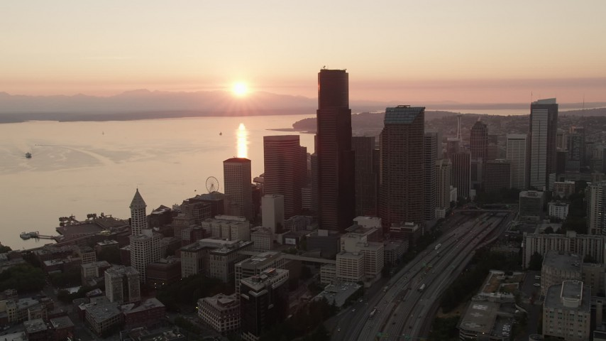 5K stock footage aerial video orbit Downtown Seattle skyscrapers at sunset in Washington, with Elliott Bay in the background Aerial Stock Footage | AX50_025