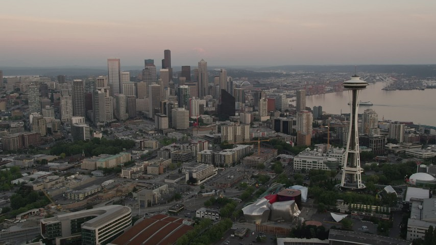 5K stock footage aerial video of orbiting around the Seattle Space Needle to reveal skyscrapers in Downtown Seattle, Washington, sunset Aerial Stock Footage | AX50_033