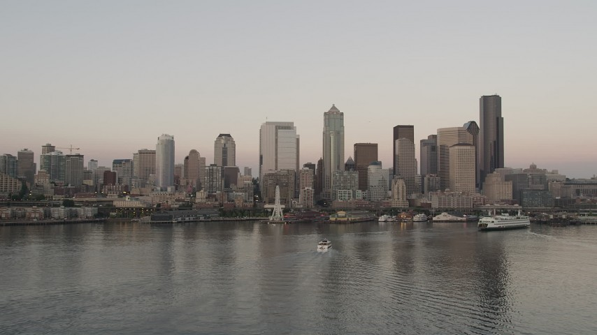 5K stock footage aerial video of the Central Waterfront and the Downtown Seattle skyline while flying by ferries sailing Elliott Bay, Washington, sunset Aerial Stock Footage | AX50_035