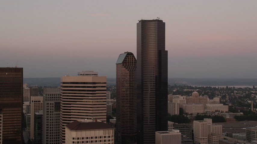 5K stock footage aerial video of approaching the Columbia Center skyscraper in Downtown Seattle, Washington, sunset Aerial Stock Footage | AX50_051