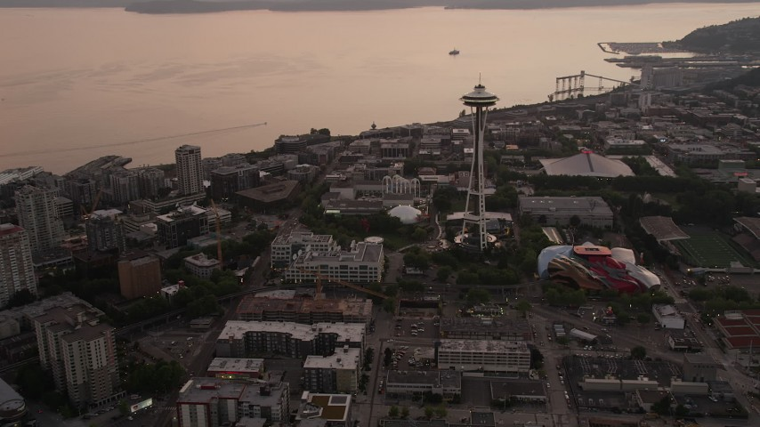 5K stock footage aerial video approach the Space Needle and the Museum of Pop Culture at Seattle Center, Downtown Seattle, Washington, sunset Aerial Stock Footage | AX50_054
