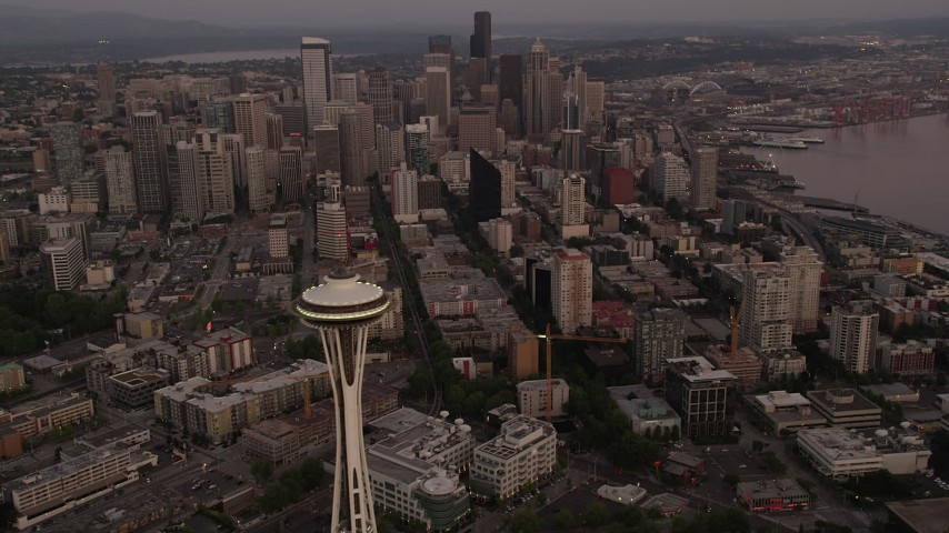5K stock footage aerial video orbit the Space Needle, tilt to reveal Downtown Seattle skyscrapers, Washington, sunset Aerial Stock Footage | AX50_055
