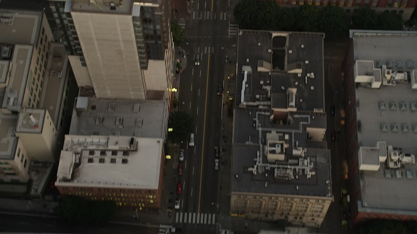 5K stock footage aerial video of bird's eye view of following 1st Avenue with light traffic through Downtown Seattle, Washington, sunset Aerial Stock Footage | AX50_057