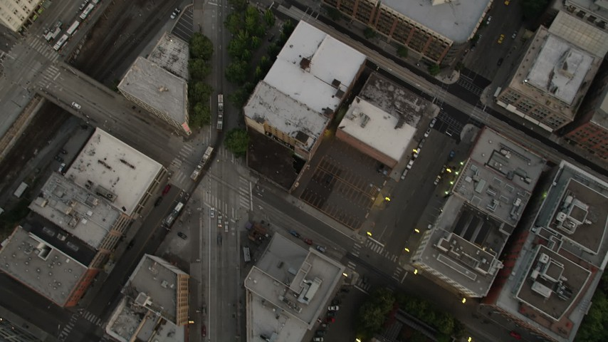 5K stock footage aerial video of bird's eye view of city streets in Downtown Seattle, Washington at sunset Aerial Stock Footage | AX50_058