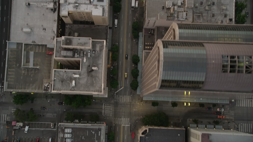 5K stock footage aerial video of a bird's eye view of light traffic traveling through downtown in Downtown Seattle, Washington, sunset Aerial Stock Footage | AX50_060