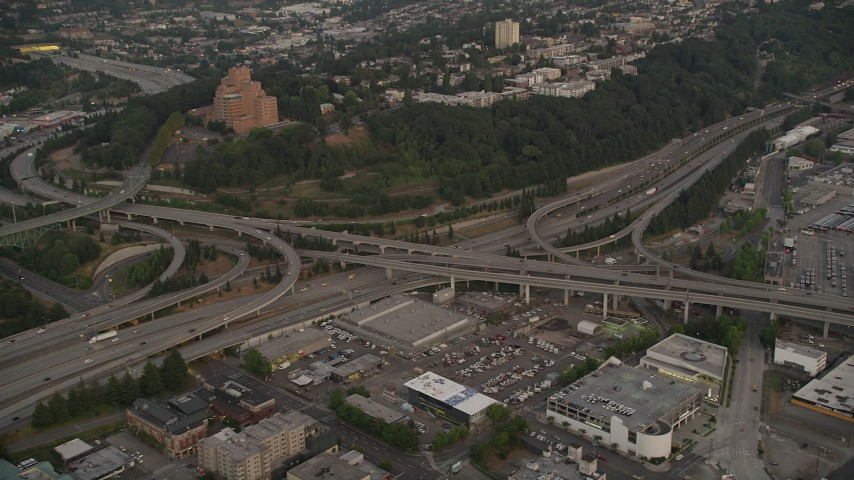 5K stock footage aerial video of the I-5 / I-90 interchange by Pacific  Tower in Beacon Hill, Seattle, Washington, sunset