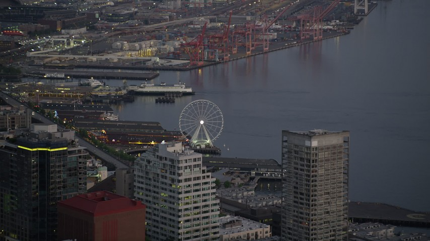 5K stock footage aerial video track the Seattle Great Wheel behind the Seattle Aquarium, Downtown Seattle, Washington, sunset Aerial Stock Footage | AX50_079