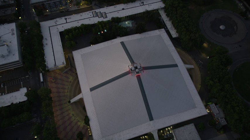 5K stock footage aerial video tilt to a bird's eye view of the KeyArena multi-purpose facility, Downtown Seattle, Washington, sunset Aerial Stock Footage | AX50_080