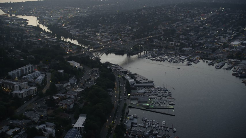 5K stock footage aerial video of the Aurora Bridge spanning the Fremont Cut, Lake Union, Seattle, Washington, sunset Aerial Stock Footage | AX50_082