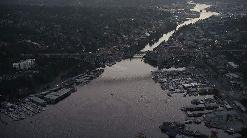 5K stock footage aerial video track Aurora Bridge spanning the Fremont Cut, Lake Union, Seattle, Washington, sunset Aerial Stock Footage | AX50_083